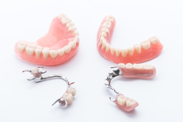 Set of dentures on white background